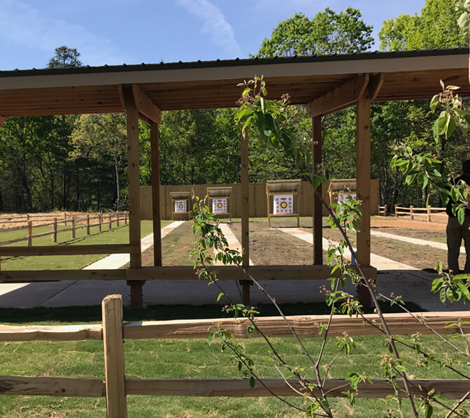 https://www.unicoilodge.com/wp-content/uploads/2017/06/672x598-ArcheryRange.jpg